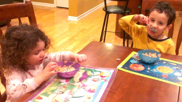 "Here are my kids, enjoying their ""breakfast"" before bedtime. Photo copyright Caroline Margolis."